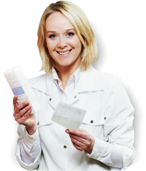 female pharmacist smiling holding a medicine box and prescription